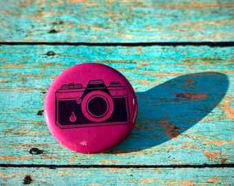 Camera button pin