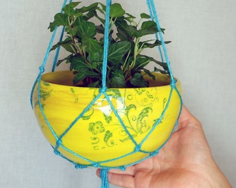 Hanging yellow planter with turquoise macramé