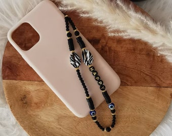 Bijoux de téléphone | Bijou de téléphone personnalisable | Grigri | Phonestraps | Cordon portable| Idée cadeau | Modèle coquillage oeil noir