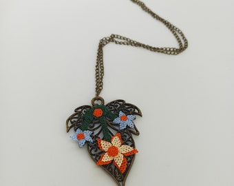 Handmade needle lace necklace on metal Special design.