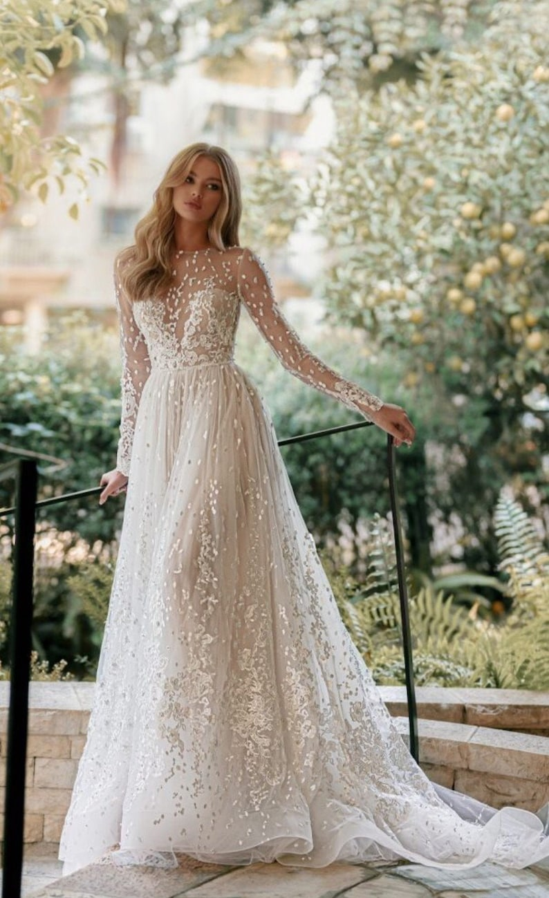 Long sleeve A-line wedding dress with open back. Church image 0