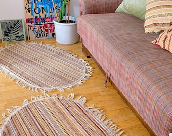 Striped pair of retro vintage accent rugs | oval shaped mats with tassels fringe | 1960s 1970s scatter-rug | California bohemian style