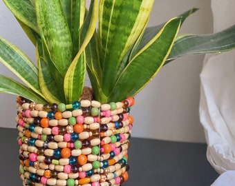 Large plant pot made from repurposed wooden and glass beads