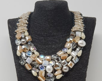 Four strands of neutral creams and champagne colored beaded bib necklace Lovely midcentury classic perfect with any outfit.
