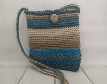 Small top-handle knitted bag \u2014Pink and blue.