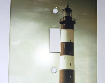 Light switch plate with lighthouse