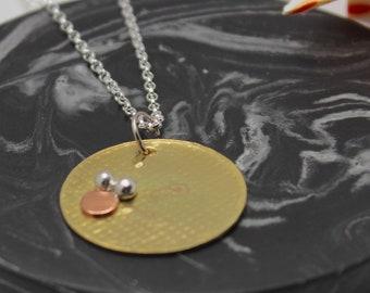Mixed metal circles pendant
