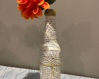Decorative Glass Bottle with Torn Book Pages, Twine Bow, and Orange Flower