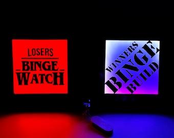 Losers Binge Watch, Winners Binge Build - Brilliant Neon Signs for Creators