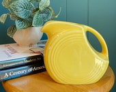 FIESTA disc pitcher vintage made in USA yellow