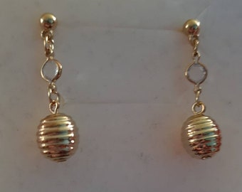 80s style gold tone drop earrings with clear crystal design and spiral base