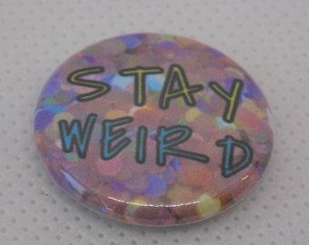 Stay weird pinback button