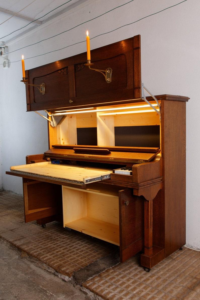 Handmade secretary in an old piano image 0
