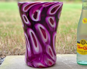 Hand blown glass vase in pinks and purples by Greg Fleischaker