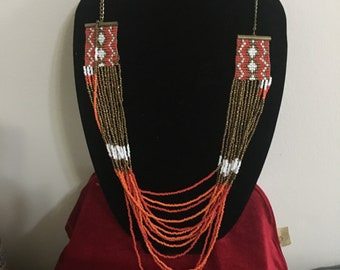 Beautiful multi-stranded, hand crafted Native American style long  woven seed bead necklace with corral, white, and bronze colored  beads