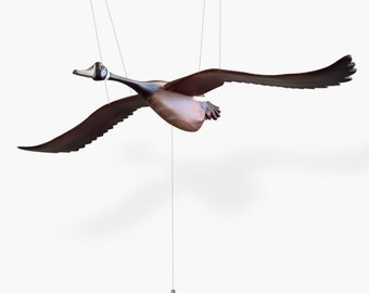 The Canadian Goose mobile is a versatile objet d'art as it not only fits into a Woodland Nursery but is statement decor piece with style