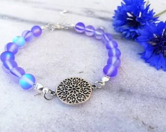 Gersimi 1.0 | Armband med lila pärlor och silverfärgad connector