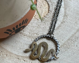 Sterling Silver Braided Circle with Brass Snake Necklace