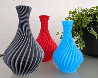 Spiral Vase in multiple colors and sizes. Unique, colorful, modern and abstract. Flowers and plants. Gift accessories for inside.