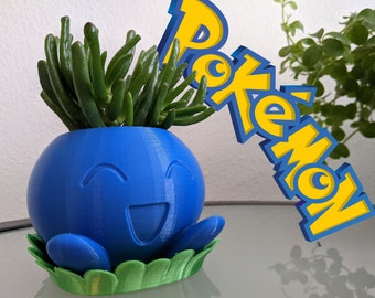 Cheerful Pokémon Oddish Planter with matching bottom plate. Deep blue and shiny green. For the plants and especially Pokémon lovers.