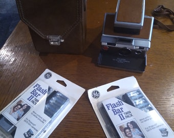 Vintage Polaroid SX-70 Land Camera with Case, Strap and Flash Packs
