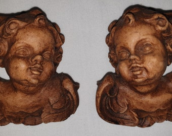 Pair of Miniature Hand Carved Wooden Putti Head Cherubs Facing Left and Right