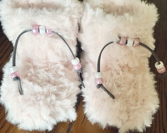 Pink furry baby booties with suede soles size 6 - 12 months