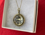 Brassy Gold Pocket Watch from The White Rabbit inspired by Alice In Wonderland on a brass chain