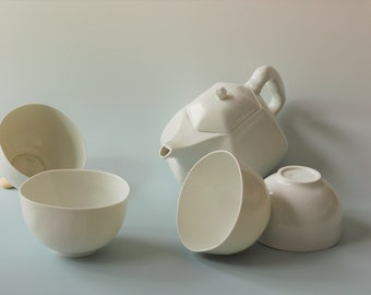 Large teapot and porcelain bowls
