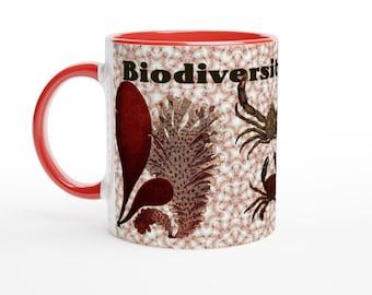 White ceramic mug. Biodiversity of sea creatures from vintage illustrations.