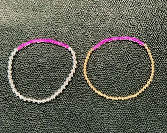 Gold or silver plated beads with a hint of pink