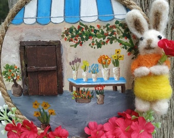needle felted rabbit and flower shop painted on wood
