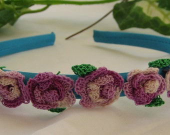 Teal Head Band Adorned with Lavender Variegated Crocheted Roses and Green Leaves