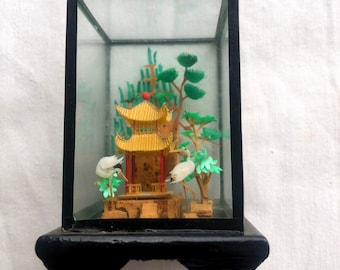 Miniature of wood and glass with oriental scene in pagodas, herons. Vintage, incredible details