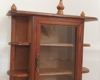 Vintage 1970's Mahogany wooden curiosity cabinet. Wooden entryway cabinet. Glass front storage cabinet. Large wall mounted shelf cabinet.