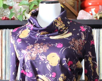 1970s vintage turtleneck top, cowl neck shirt with novelty fruit print, eggplant purple with grapes, bananas... approx womens medium large