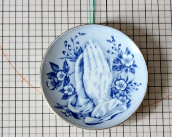 small vintage praying hands plate, blue and white wall hanging, kitchen decor