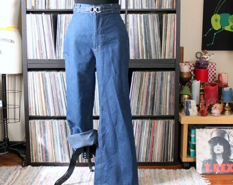 1970s vintage jeans, bellbottoms flares by K-Mart with attached buckle belt, unworn deadstock with original tag attached