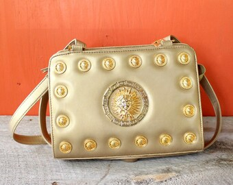 2ca9bcf7d43b vintage Greek key   Medusa purse . Medusa head shoulder bag . Bags by Marlo  . 1990s gold purse