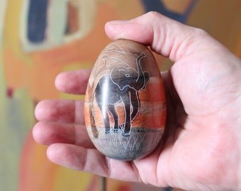 vintage soapstone egg with hand carved elephant from Kenya, African etched stone
