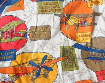 vintage airplane curtain panel, colorful biplane print with pinch pleats