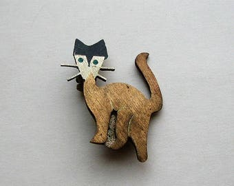 small vintage cat pin, mid century figural mixed metals with turquoise inlay eyes, made in Mexico