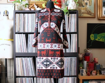 1970s vintage knit dress with thunderbird print, long sleeves