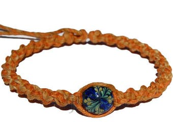 Golden brown and pumpkin twisted wide hemp necklace blue glass bead with green flower