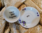You've been poisoned bye teacup saucer altered china gift custom purple pansy personalized poison cup message at bottom calligraphy murderin