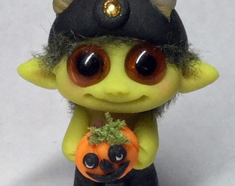 """Goblin guard Trollfling troll with a pumpkin """"Brewster the Bold"""" by Amber Matthies"""