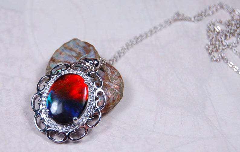 Spectacular Ammolite jewelry pendant rich in reds and blues.Grade AA.#123017
