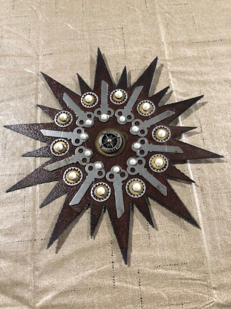 Starburst compass on Vintage Roofing Tin Assemblage Found Art image 0