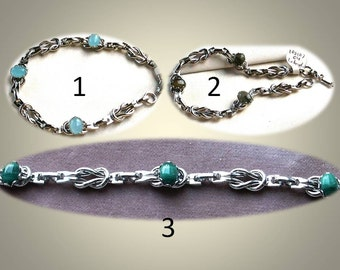 Silver Tone Reef Knot Link Bracelet with 8x6mm Bezel Set Cabochons in Three Varieties