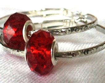 Nickel Plated Steel Hoop Earrings with Faceted Red Free Floating Crystal Beads